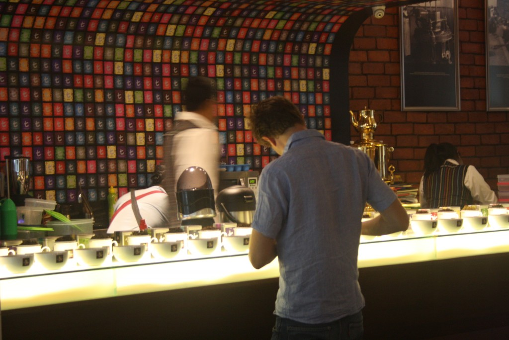 Time for tea: Lincoln studying the menu at the Dilmah Tea Shop