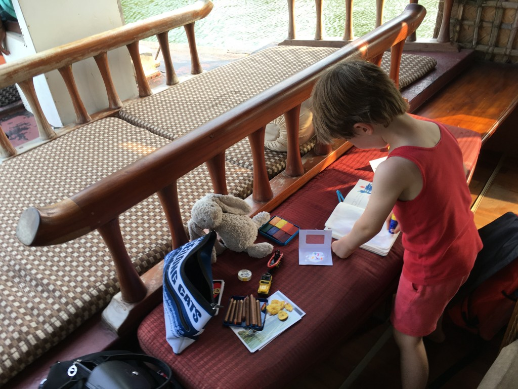 Working on the travel journal while on a house boat in Kerala